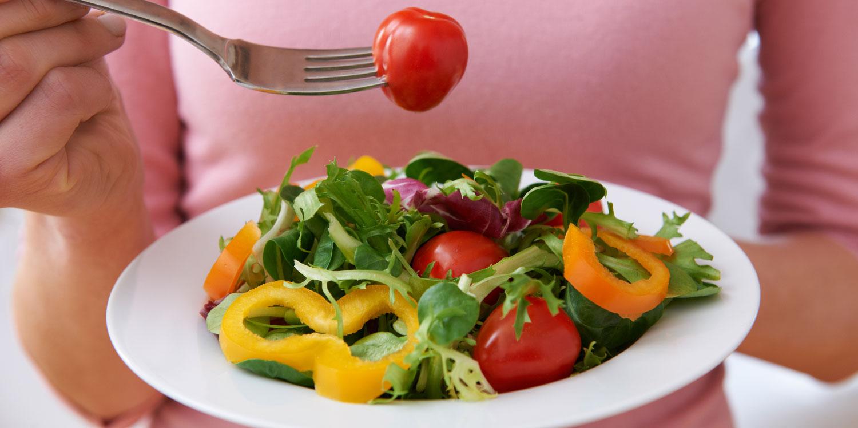 woman eating healthy salad